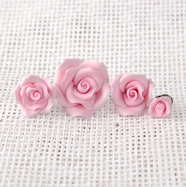 "Petite Unwired Gumpaste Sugar Roses in Pink. Includes 4 different sizes ranging from 0.5"" to 1.5"""
