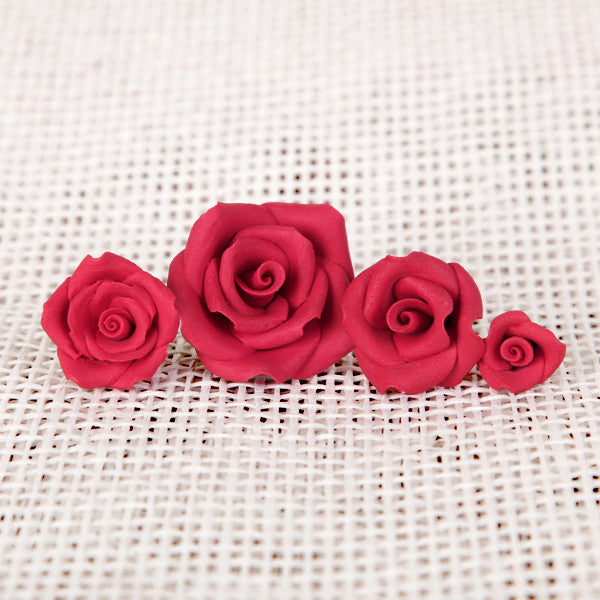 "Petite Unwired Gumpaste Sugar Roses in Red. Comes in 4 different sizes ranging from 0.5"" to 1.5"""