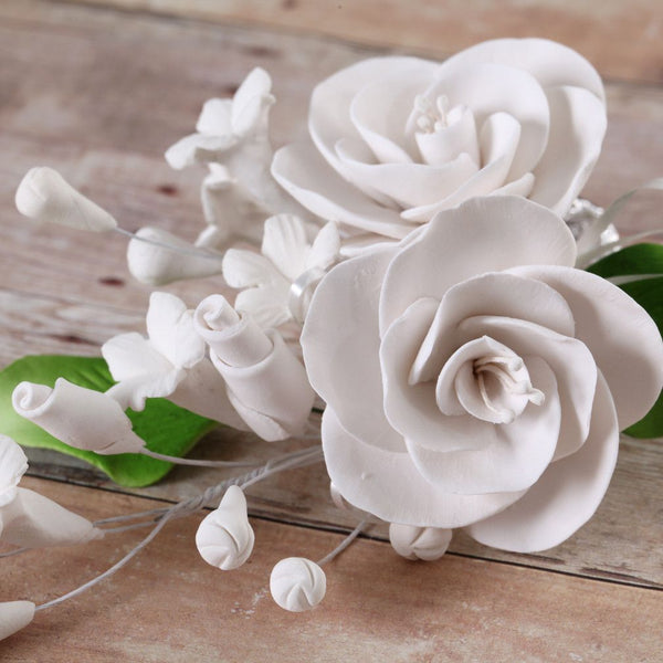 White Gumpaste Dog Rose Spray Cake Decoration perfect for cake decorating rolled fondant wedding cakes, buttercream birthday cakes, & cupcakes.  Wholesale cake decorations & cake decorating supply.
