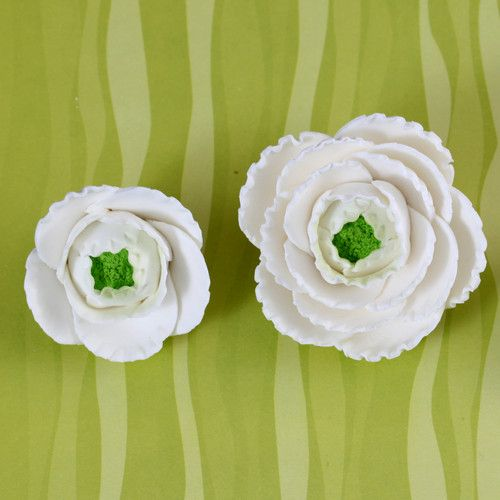 White Gumpaste Ranunculus sugarflower handmade cake decoration perfect as a cake topper for cake decorating fondant cakes.  Wholesale sugarflowers and bakery supply.