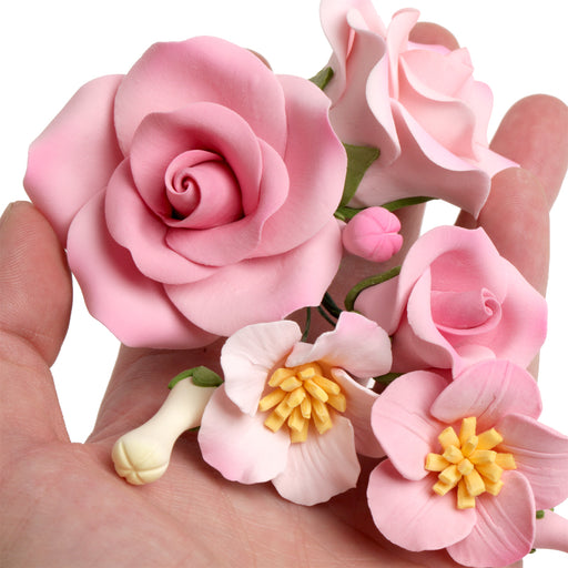 Pink Bride Rose gumpaste sugarflower cake decoration perfect as a cake topper for cake decorating fondant cakes and wedding cakes.  Wholesale sugarflowers.