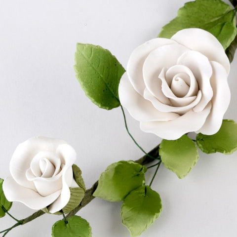 White Rambling Rose Sugarflower Spray with green leaves cake topper perfect for cake decorating rolled fondant wedding cakes and fondant birthday cakes.  Wholesale cake supplies. Caljava