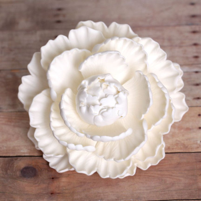 White Closed Gumpaste Peony sugarflower cake toppers perfect for cake decorating rolled fondant wedding cakes and birthday cakes.  Wholesale cake supply & sugarflowers.  Large white closed gumpaste peony handmade cake decoration.  Gumpaste flower. Caljava