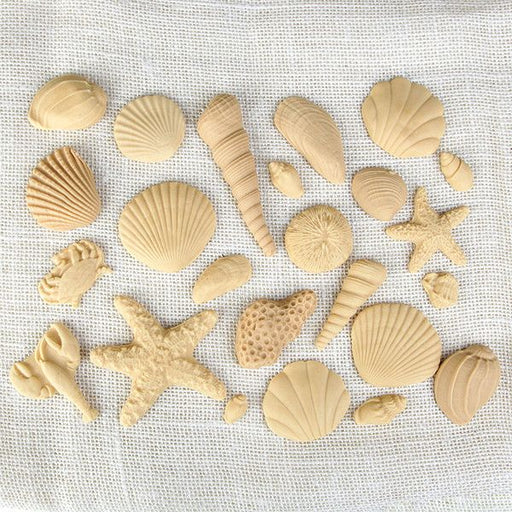 "These fun edible fondant Ivory Sea Shells are perfect additions for any ""Under the Sea"" themed cakes."