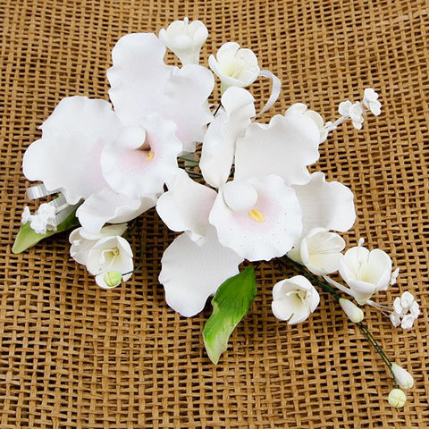Double Dendrobium Orchid Sprays in Pink are gumpaste sugarflower cake decorations perfect as cake toppers for cake decorating fondant cakes and wedding cakes. Caljava wholesale cake supply.