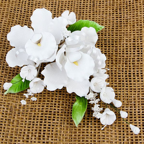 Double Dendrobium Orchid Sprays in White are gumpaste sugarflower cake decorations perfect as cake toppers for cake decorating fondant cakes and wedding cakes. Caljava wholesale cake supply.