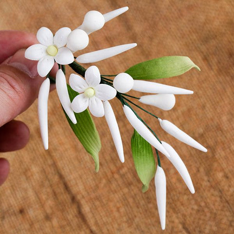 Jasmine Fillers are gumpaste sugarflower cake decorations perfect as cake toppers for cake decorating fondant cakes and wedding cakes. Caljava wholesale cake supply.