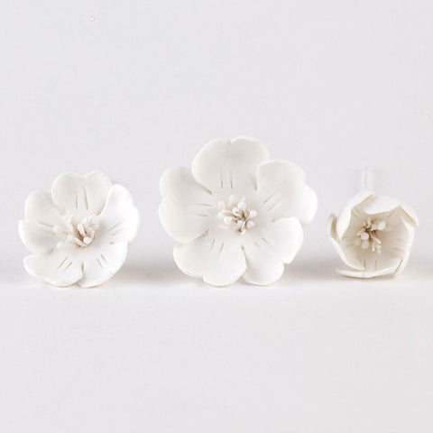 White Gumpaste Cherry Blossom Sugarflower cake decorations perfect for cake decorating fondant wedding cakes and birthday cakes.  One of our most popular flower designs.  Perfect for putting on a cupcake on in bunches.  Wholesale sugarflower and cake supply. Caljava
