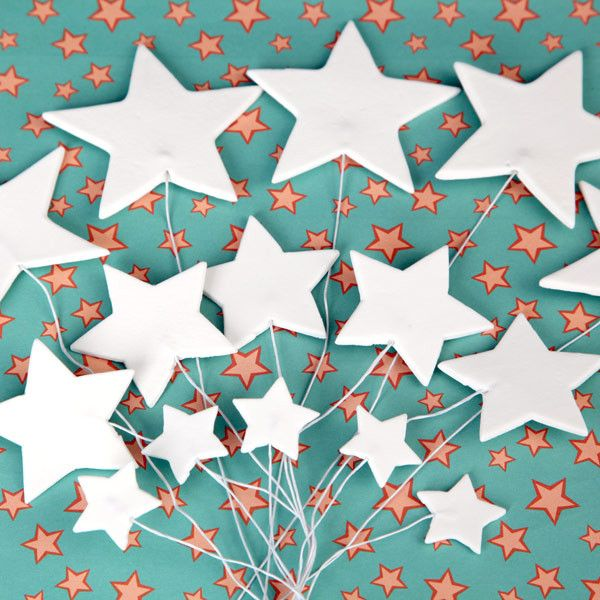 Fondant Star Appliques cake toppers are perfect for cake decorating fondant cakes & wedding cakes. Handmade ready to use.  Wholesale sugarflowers & cake supply.