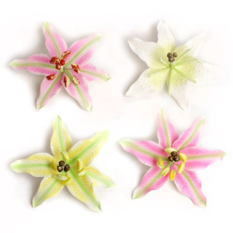 Stargazer Lilies gumpaste sugarflower cake decorations perfect as cake toppers for cake decorating fondant cakes and wedding cakes. Wholesale sugarflower. Cake supply.