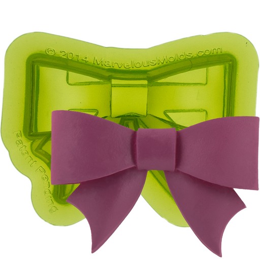 Classic Bow Fondant Mold designed to easily create perfect bows for decorating your cakes and other foods.