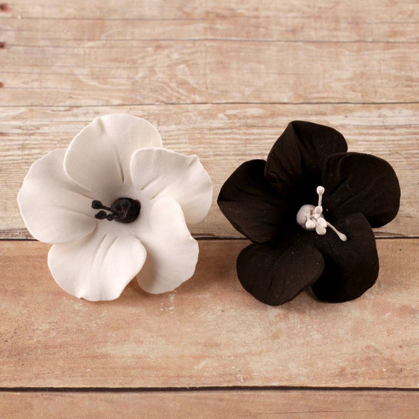 Black and White Fruit Blossoms handmade from gumpaste cake decorations and cupcake decorations perfect for rolled fondant cakes and wedding cakes.