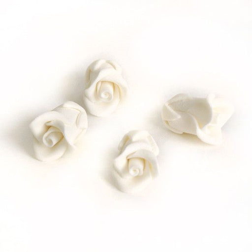Edible Gumpaste White Tiny Roses No Wire sugar flower cake toppers and cake decorations perfect for cake decorating rolled fondant wedding cakes, cupcakes and birthday cakes and cupcakes.  Edible Cake Decoration and wholesale cake supplies.