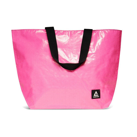 Pink Tote for carrying your personal and cake items around with you. Made with recycled billboard material.