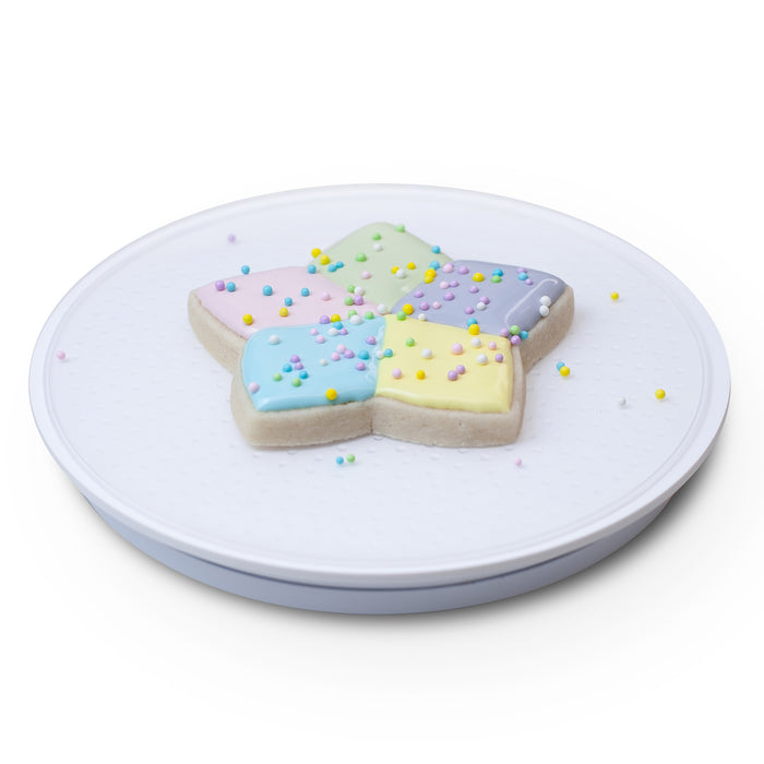 Acrylic Cookie and Cupcake Turntable makes for easy decorating.  Features a 6 inch surface with a smooth non-wobbly spin, and silicone textured surface to cold your cookie in place.  Cookie decorating tool.