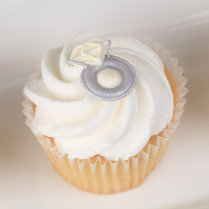 Royal Icing Toppers for decorating your own cupcakes, chocolates, cookies, cakes, and other desserts. Edible hand piped icing toppers ready to use on your food.