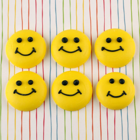 Happy Smiley Face Cupcake Toppers from royal icing for cupcake decorating and cake decorating fondant birthday cakes.  Wholesale cake decorating supplies.  Cake decorations.  Edible cupcake decorations.