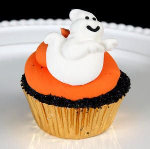 Cheerful Edible Fondant Ghosts cupcake toppers perfect for halloween cakes and cupcakes.
