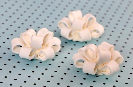 Fondant Cupcake Bows in White. Wholesale available.