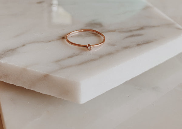 Rose gold ring with 2mm round diamond.