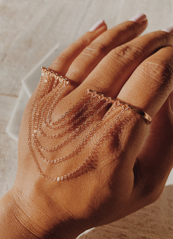 Thick palm cuff: Rose gold palm cuff with chains.