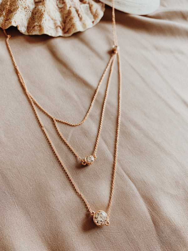 Rose gold tri-strand necklace with three Swarovski crystals.