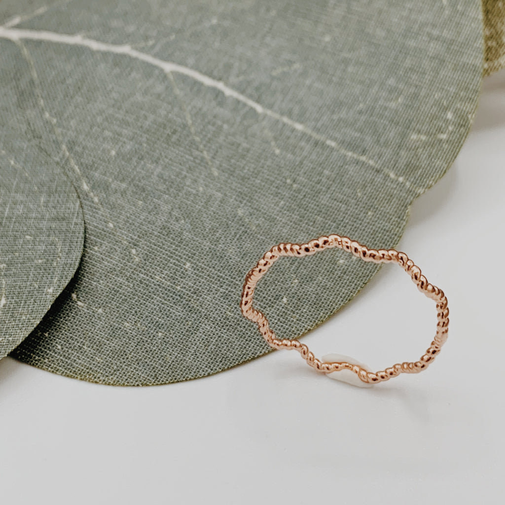 Wave rose gold ring either smooth or braided texture.