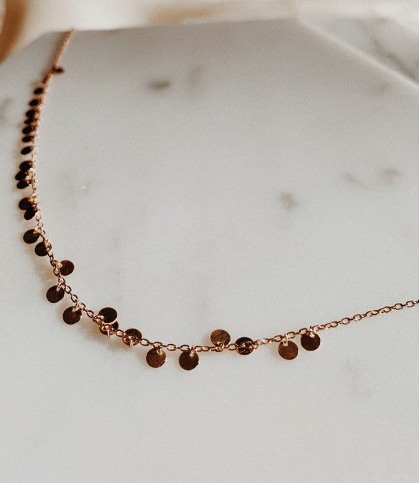 Rose Gold anklet with gold discs.