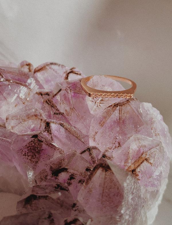 Rose gold ring with ten cubic zirconias.