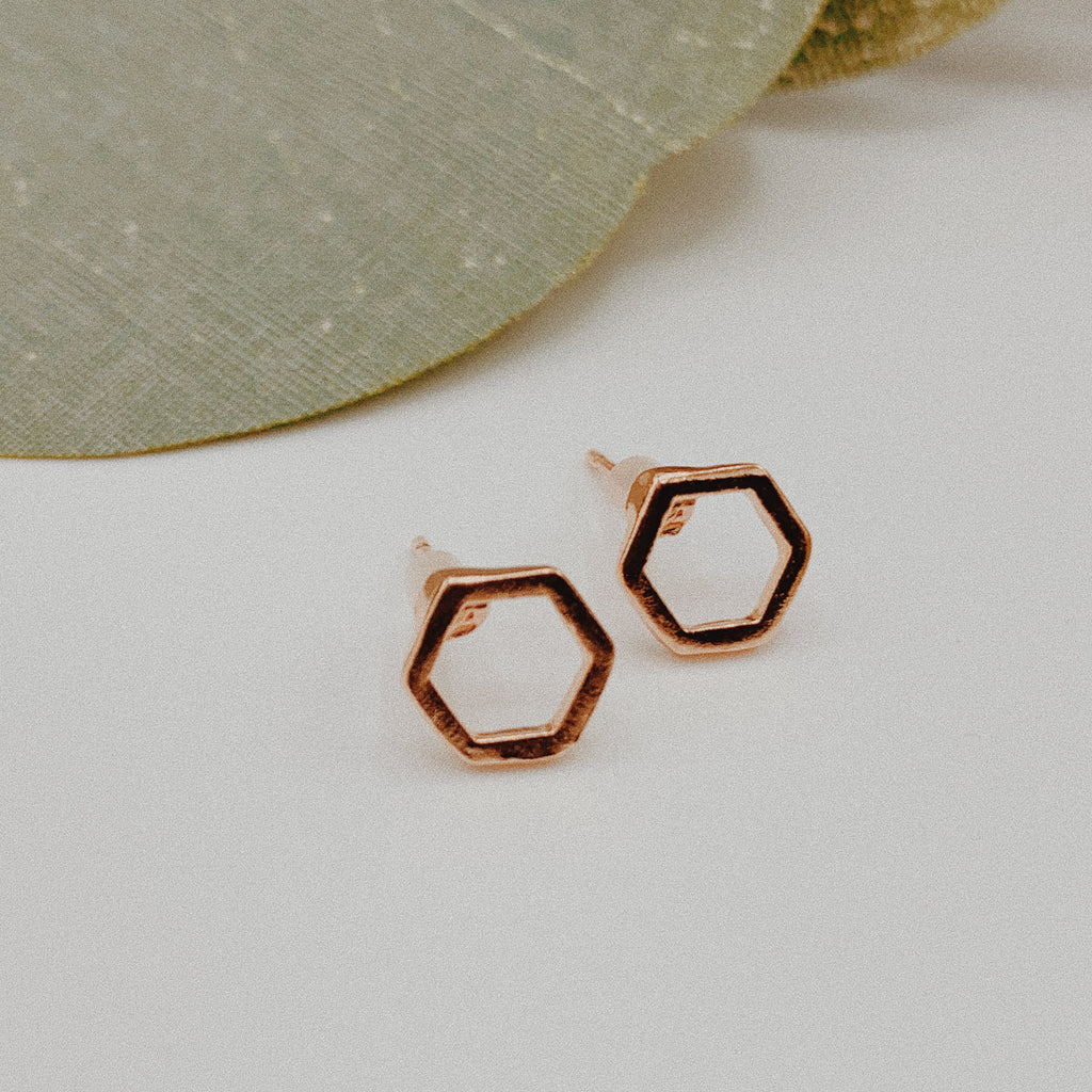Rose gold polygon earrings.