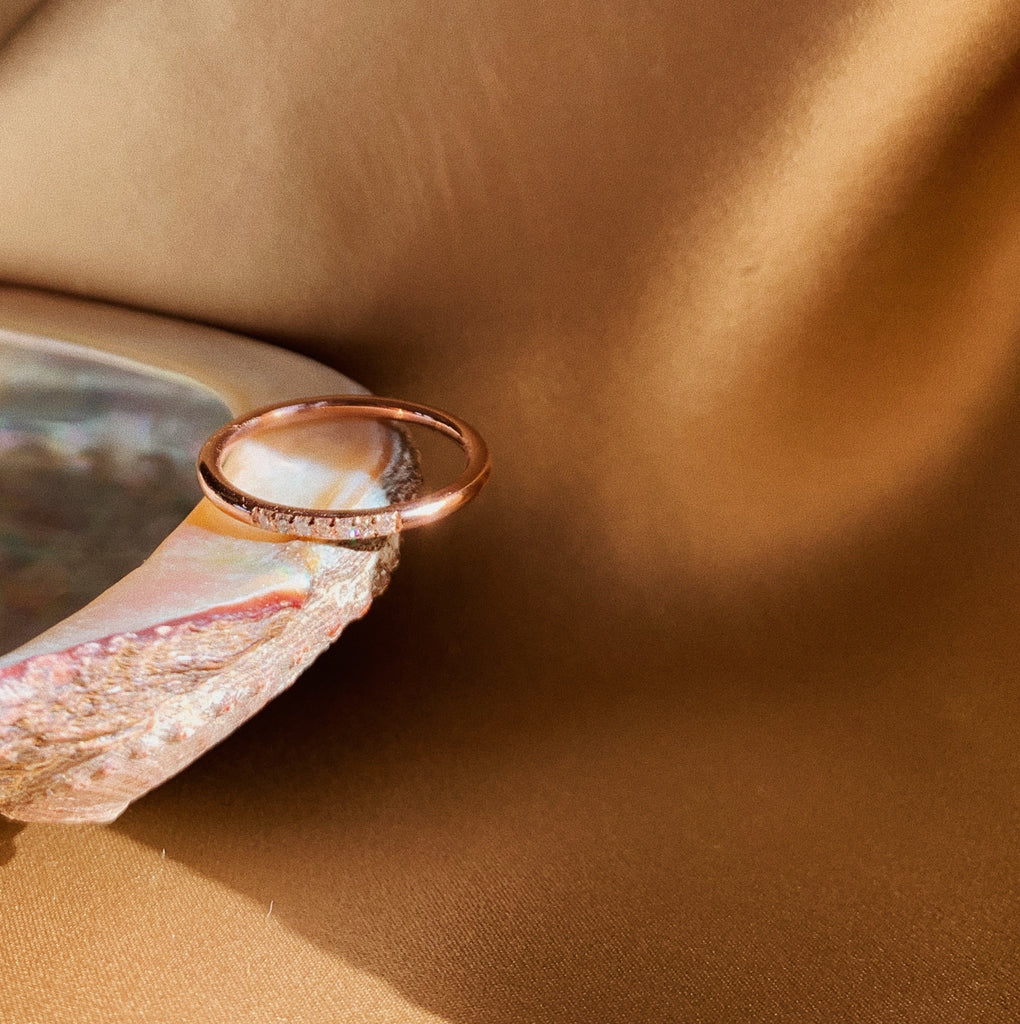 Rose gold ring with seven diamonds.