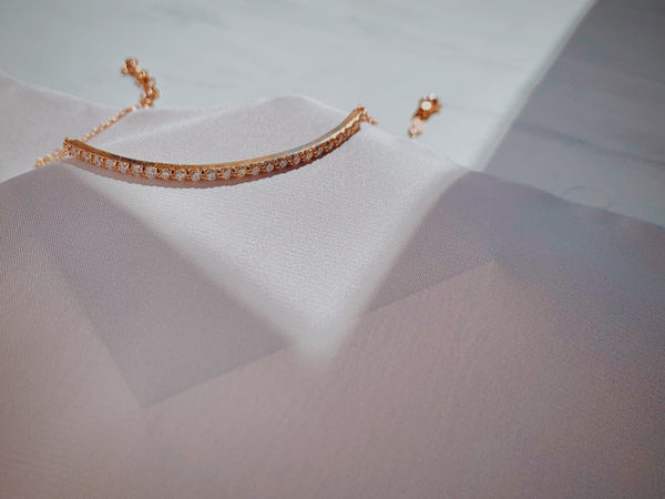 Rose gold diamond bar bracelet with 24 diamonds.