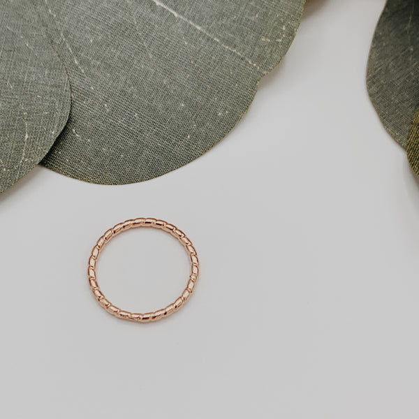 Braided rose gold ring.