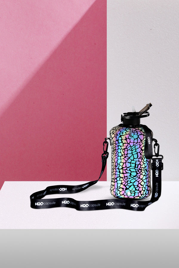 Cheetah Reflex  - H2O Capsule 2.2L Half Gallon Water Bottle with Reflective Sleeve and straw lid