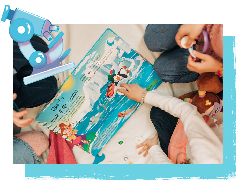 Children playing with The Adventures of Lillicorn book using charm tokens by STEM educational publisher QuestFriendz