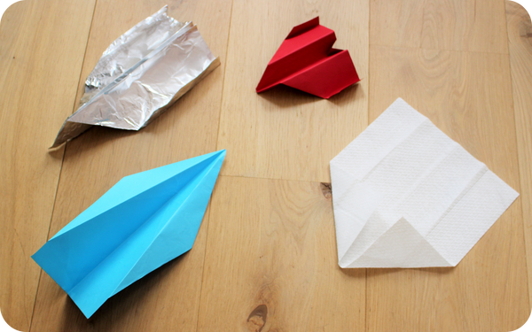 Paper airplanes made of different materials