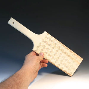Paddle With Fish Scale Pattern