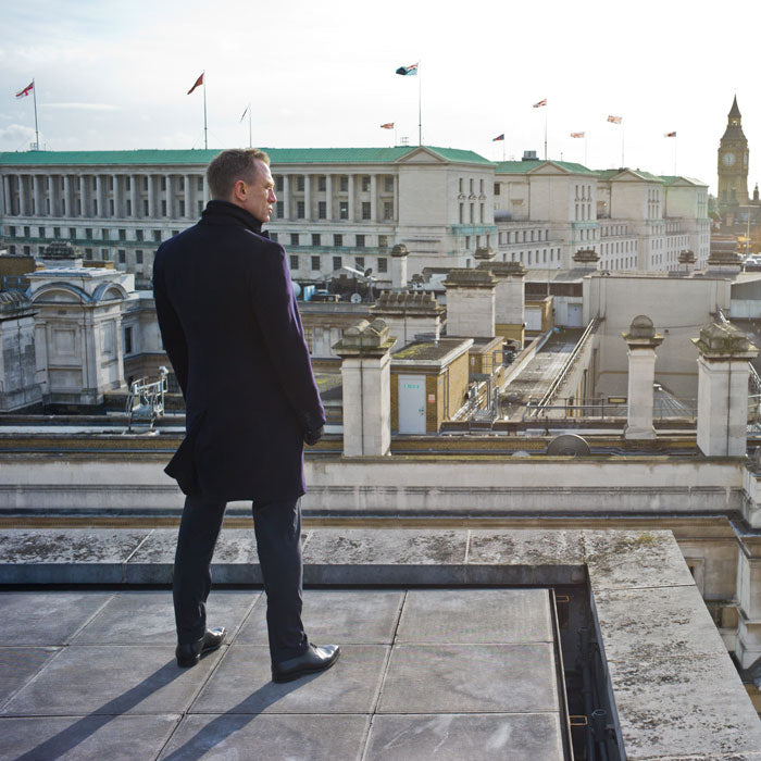 Daniel Craig as James Bond on a rooftop overlooking London