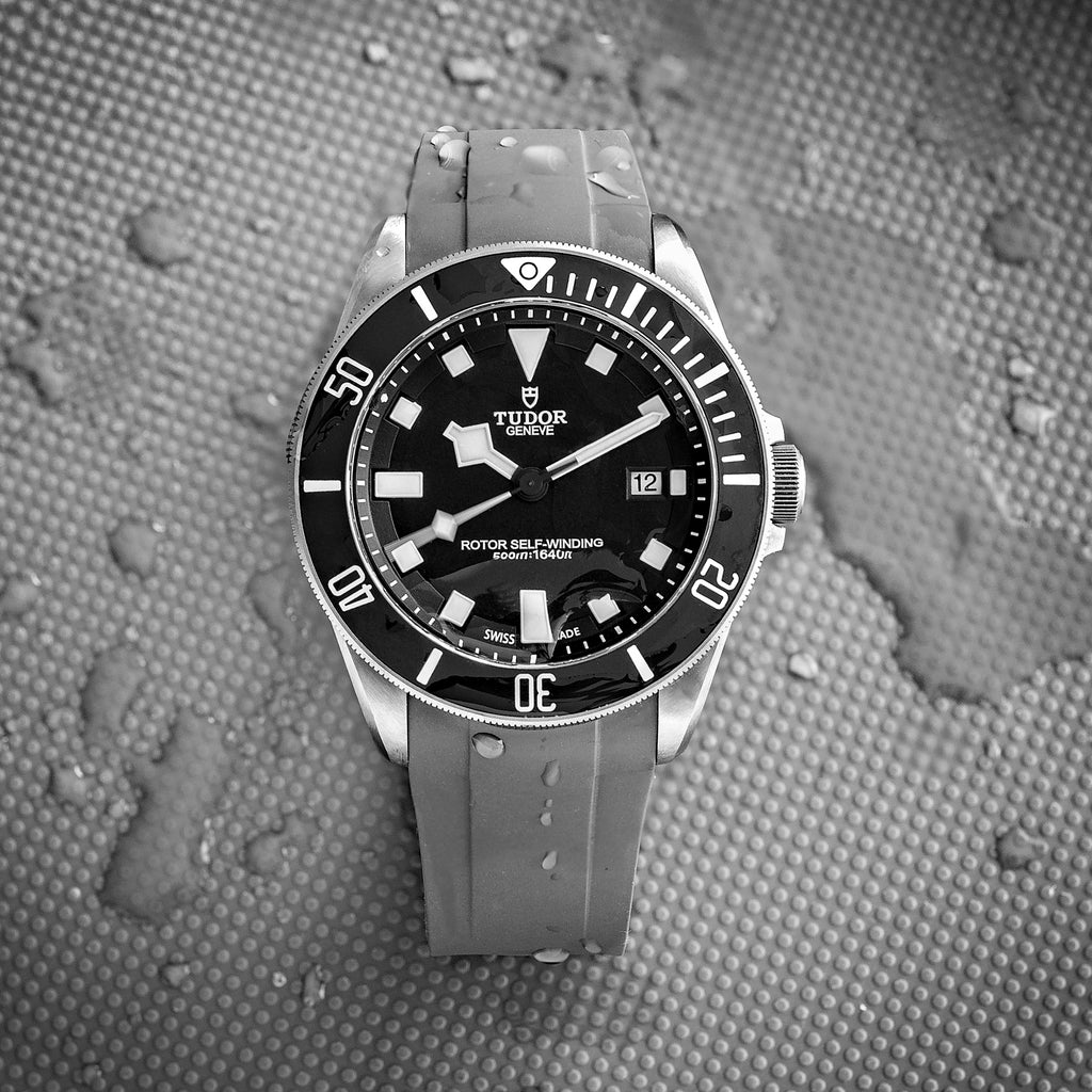 Crafter Blue rubber watch strap in grey fitted to a black Tudor Pelagos