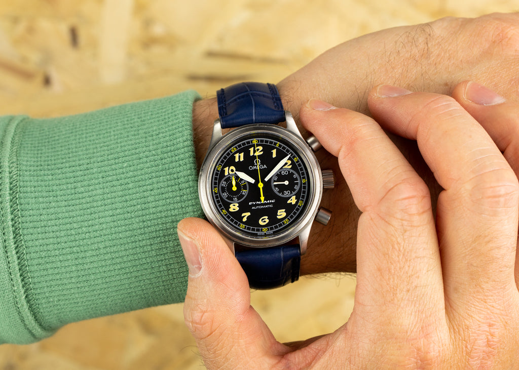 Omega Dynamic watch with blue Hirsch Duke fitted to it on the wrist