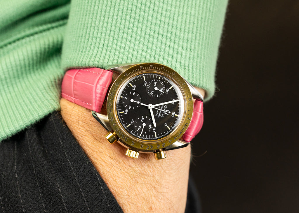Pink watch strap on an Omega Speedmaster