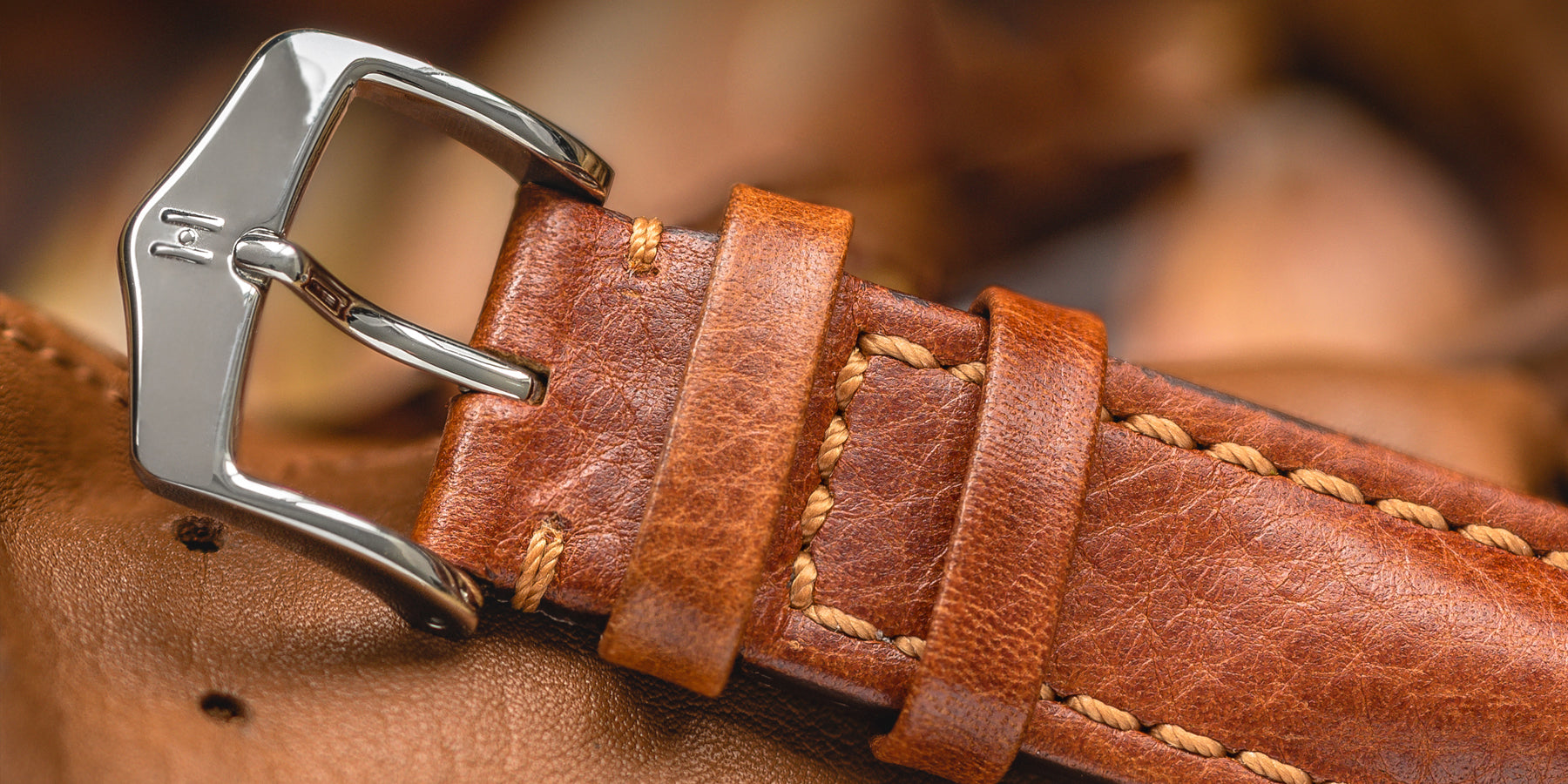Golden brown hirsch lucca watch strap and polished buckle