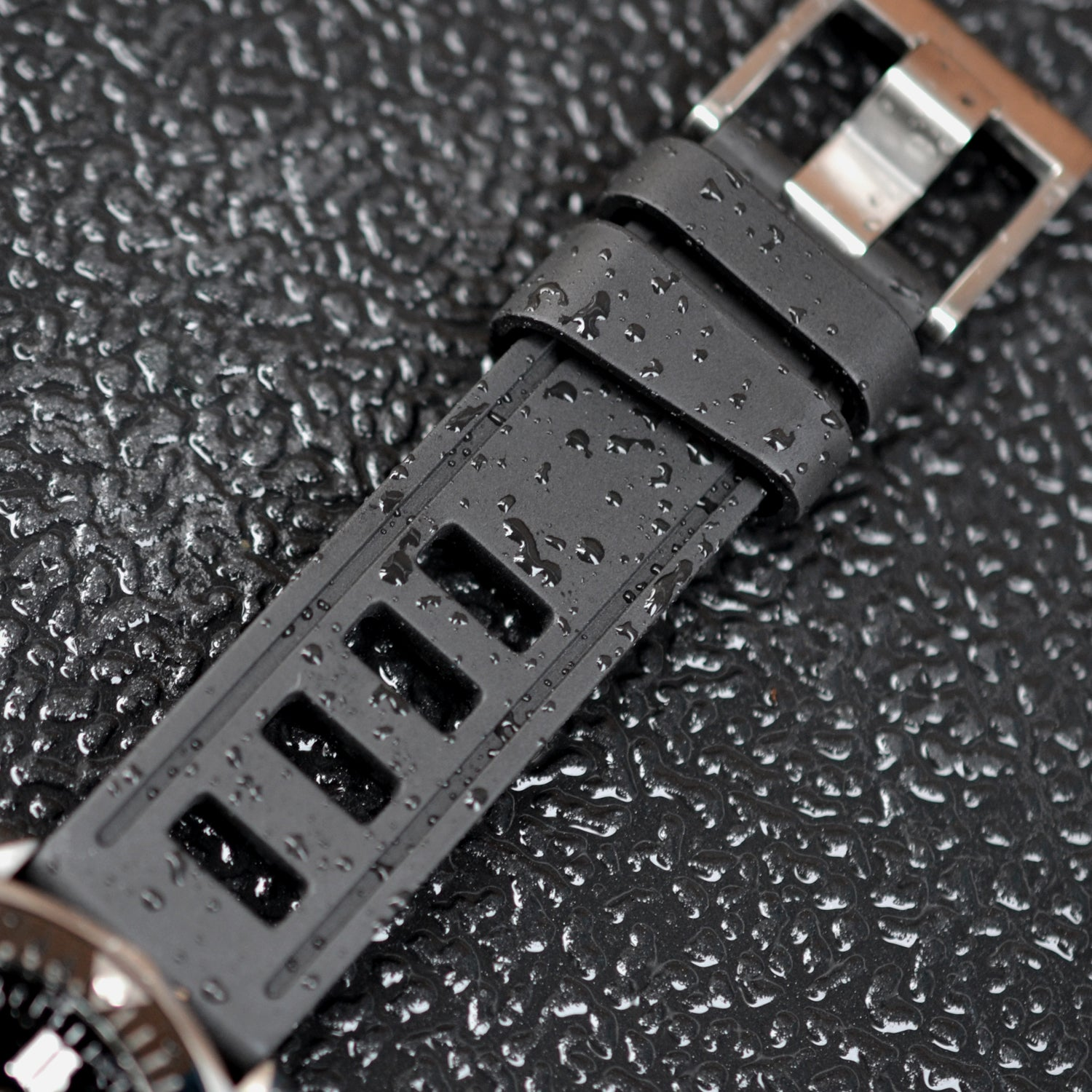 Black ISOfrane watch strap with water droplets on it