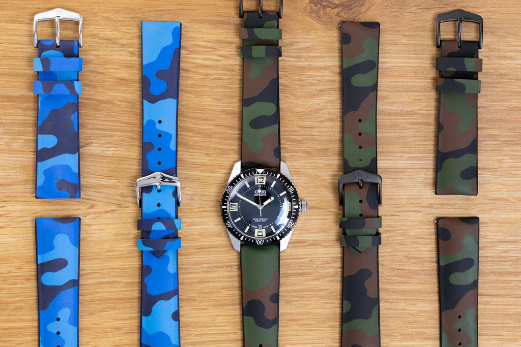 Row of Hirsch John watch straps with one fitted to an Oris 65 Diver
