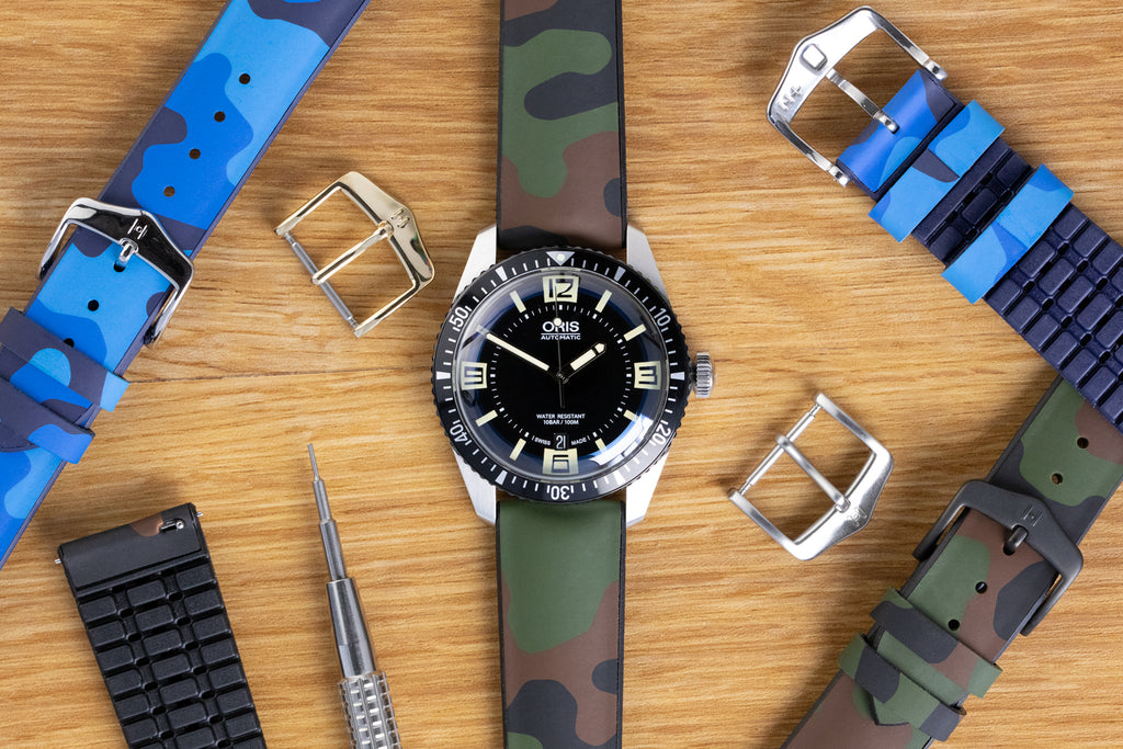 Multiple watch straps and buckles with spring bar tool and divers watch