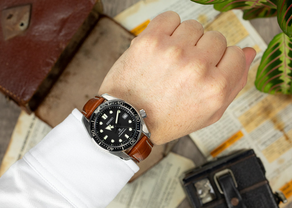 Cognac Rios1931 New Orleans and Seiko dive watch on the wrist