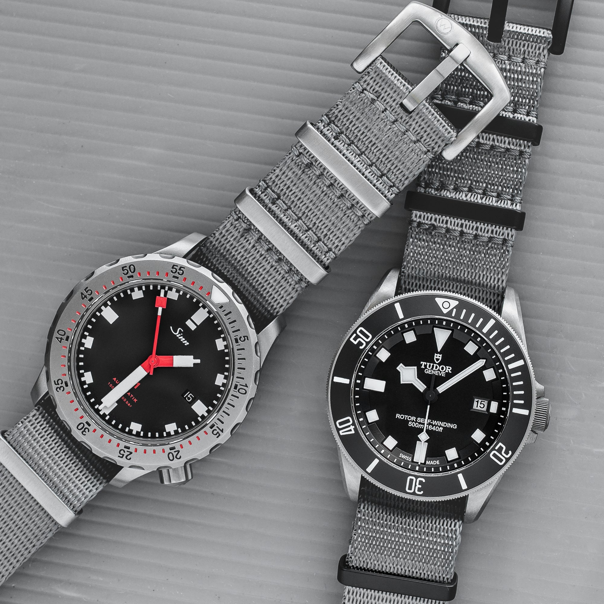 Sinn and Tudor watches both with seat belt nato straps fitted