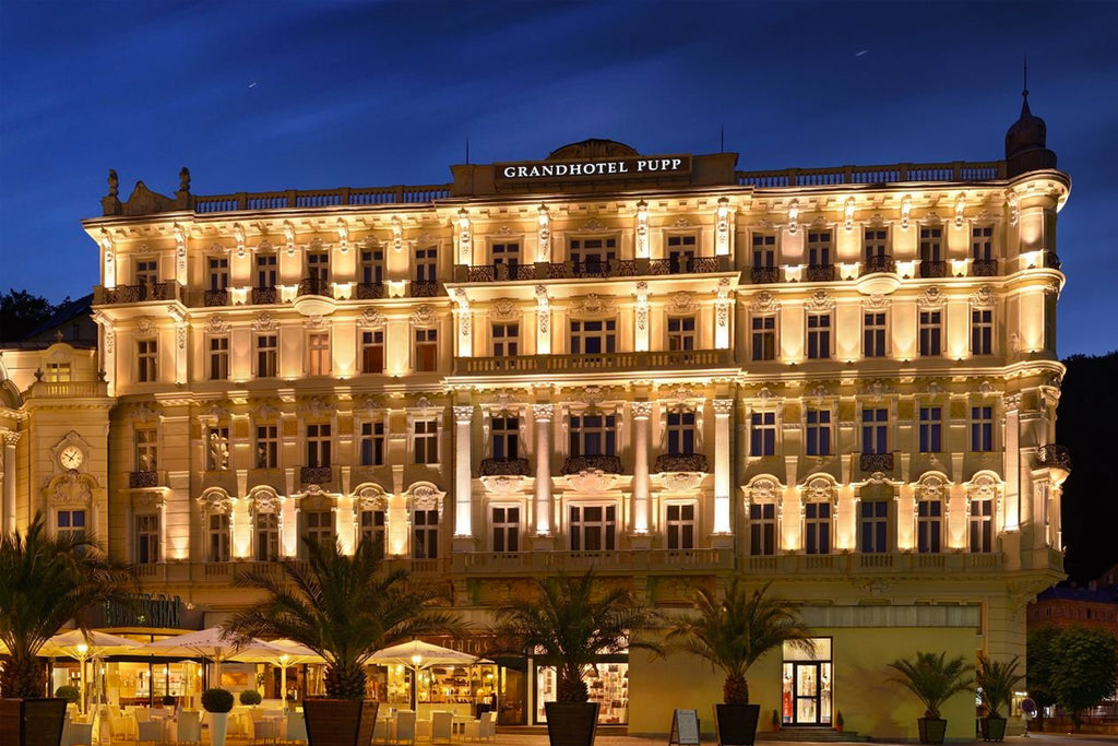 The front of the Grandhotel Pupp at night