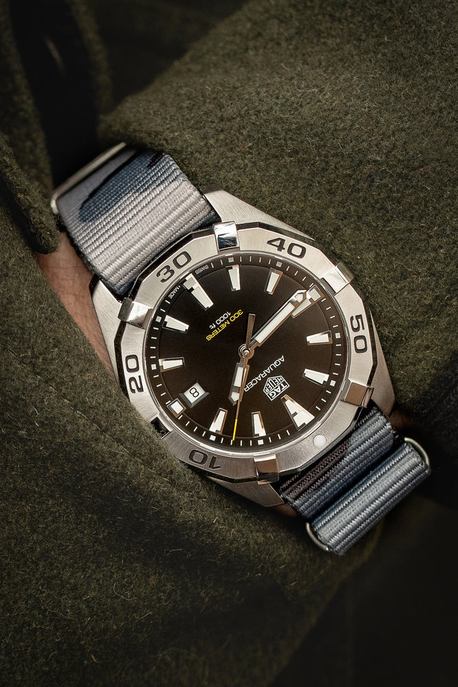Load image into Gallery viewer, Hirsch Rush Nylon NATO Watch Strap in Grey Urban Camouflage (Promo Photo & Wrist Shot on Tag Heuer Aquaracer)