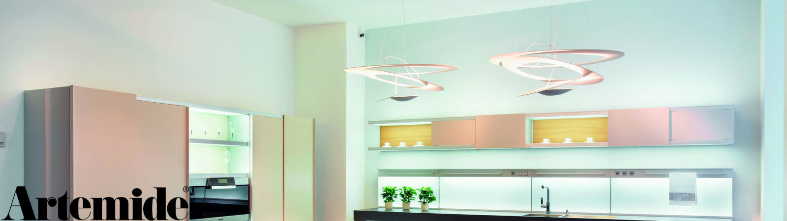 The Pirce Suspension Light from Artemide, available at Sportique.com